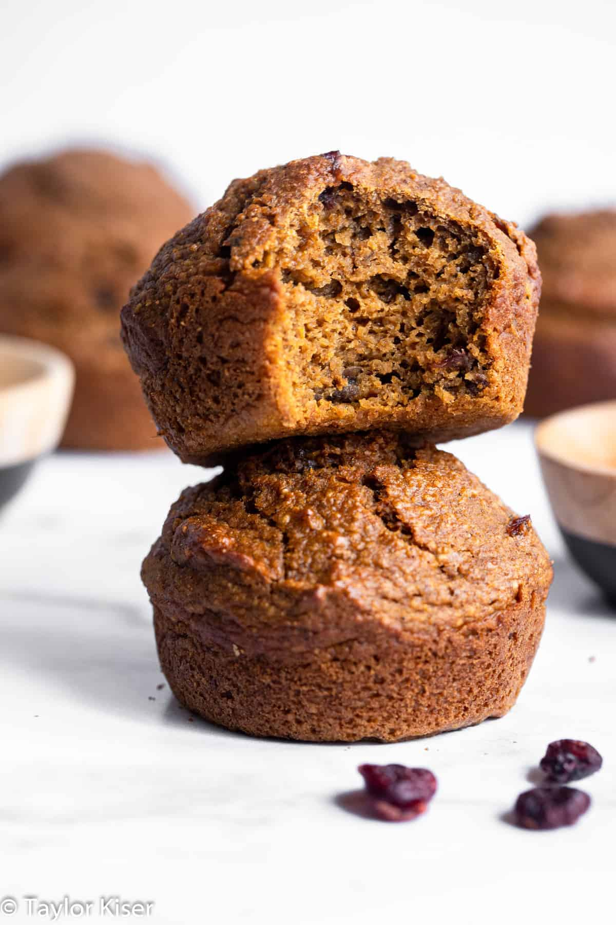 2 healthy gluten free pumpkin muffins stacked on top of each other