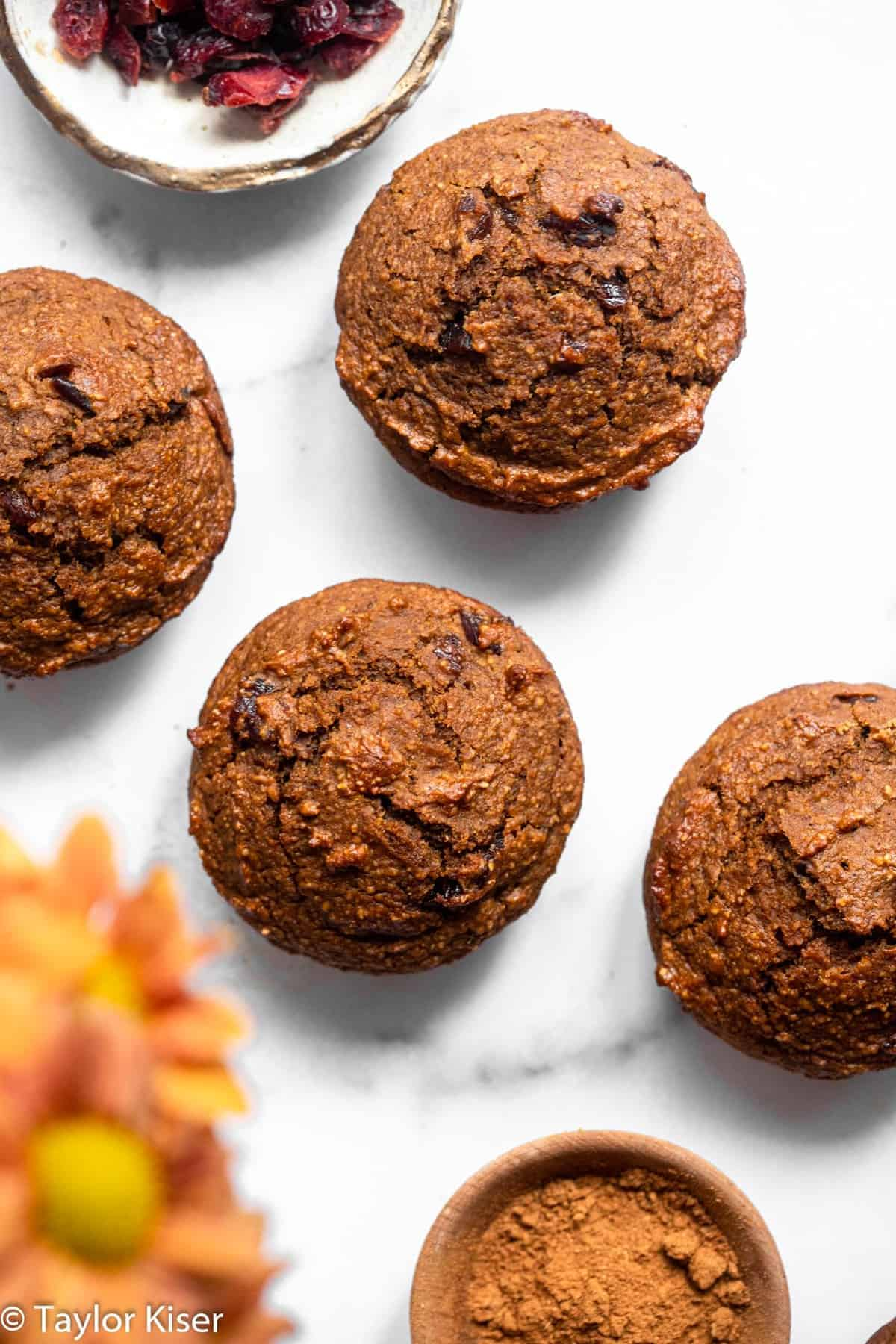 close up of the tops of gluten free pumpkin oatmeal muffins