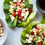 Low Carb Chicken Larb Gai Lettuce Wraps - An easy, healthy twist on a classic Thai salad! They're low carb, paleo friendly and super easy to make! Great for quick weeknight dinners! | #Foodfaithfitness | #glutenfree #lowcarb #paleo #healthy #Thai