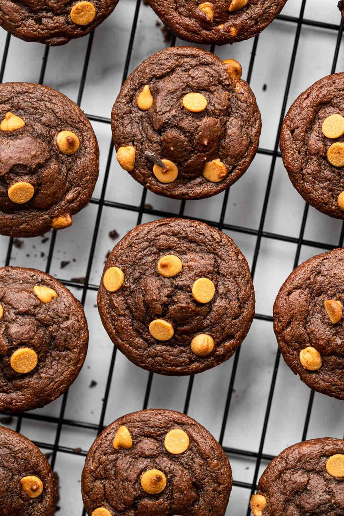 Peanut butter chocolate chip muffins on a cooling rack