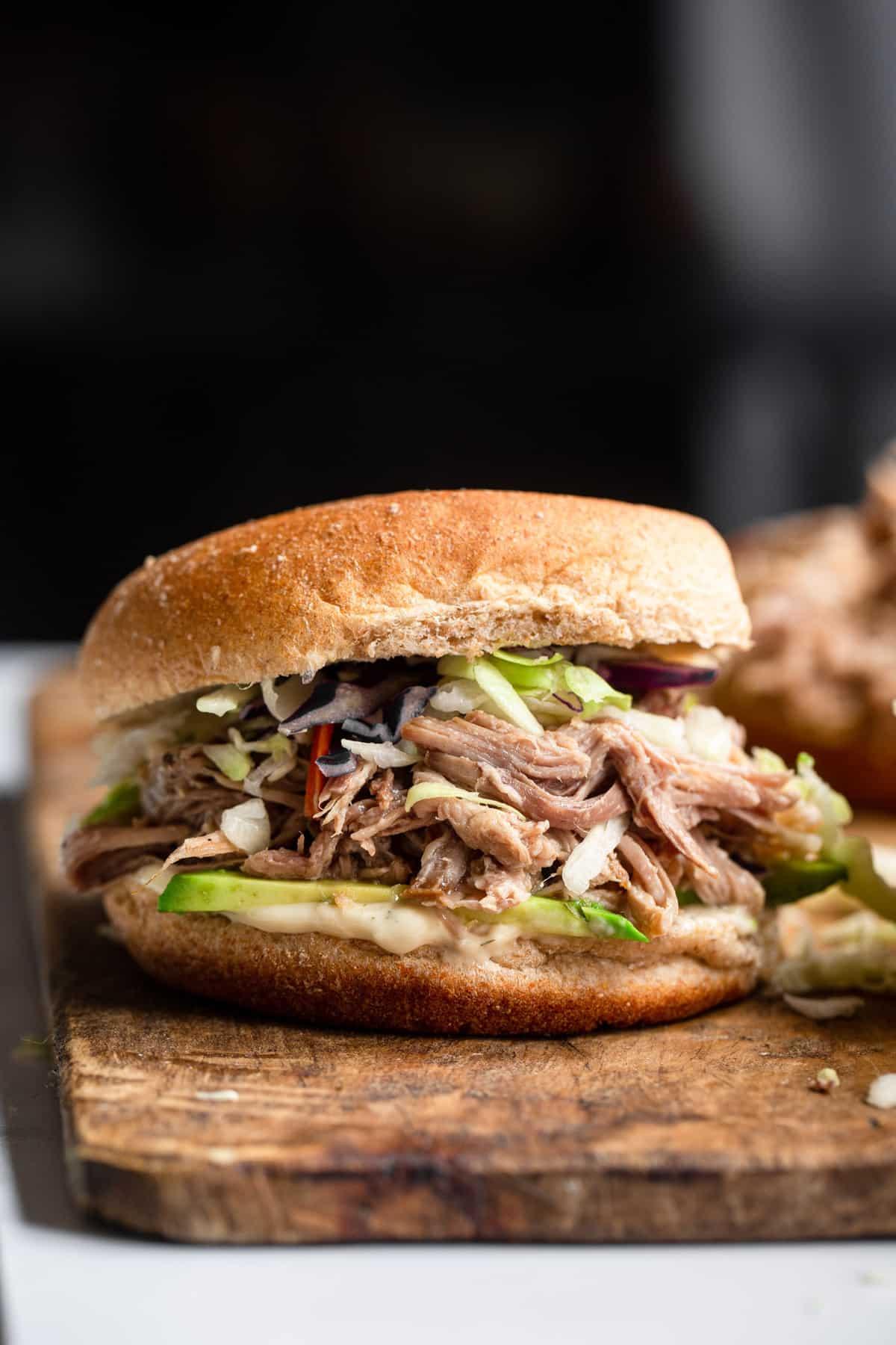one keto pulled pork sandwich on a cutting board