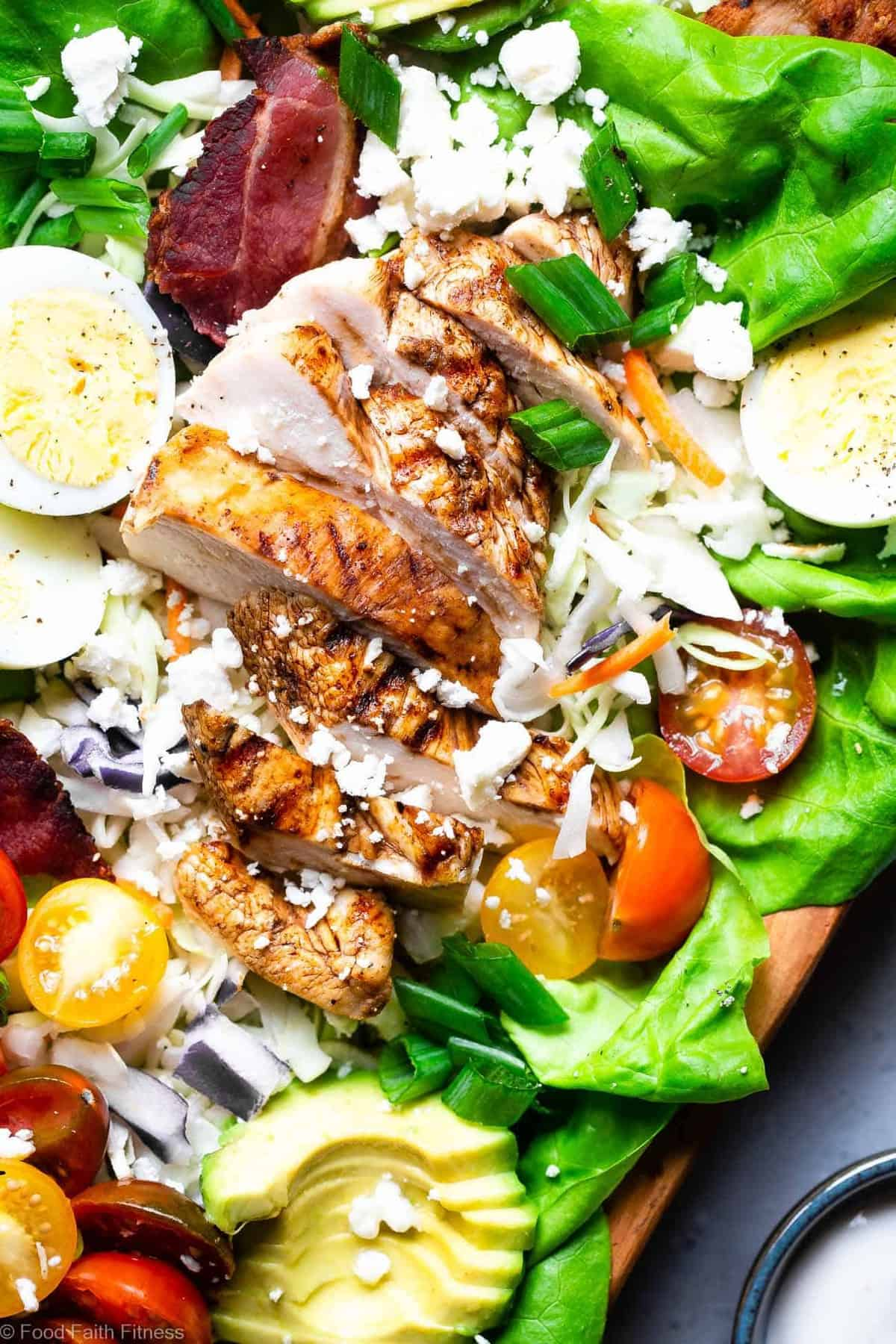 Healthy Chicken Cobb Salad Recipe - This quick, easy skinny Chicken Cobb Salad Recipe is a lighter remake that cuts over half the calories of the classic but not the taste! No one will know it's lighter, gluten free and lower carb! | #Foodfaithfitness | #Glutenfree #lowcarb #healthy #salad #grainfree