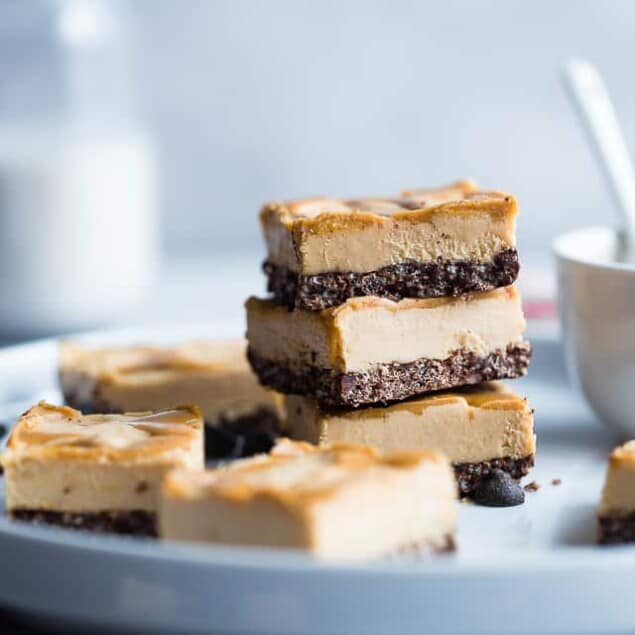Dairy and Gluten Free No Bake Peanut Butter Cheesecake Bars - A super easy dessert with a yummy, crunchy chocolate rice krispie crust. You'd never know that they are gluten free, dairy free and made with better for you ingredients! | #Foodfaithfitness | #GlutenFree #DairyFree #Healthy #Peanutbutter #NoBake