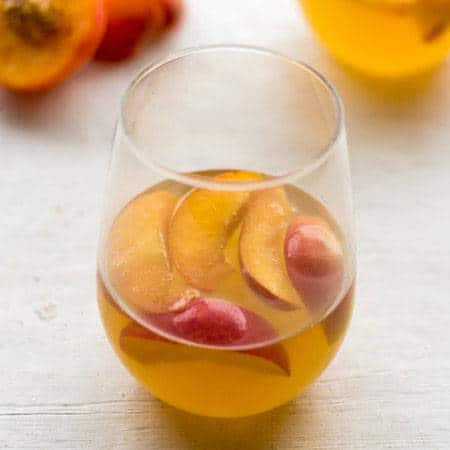 White Wine Cocktail with Peaches and Honey Fig Syrup {GF} - Food Faith Fitness