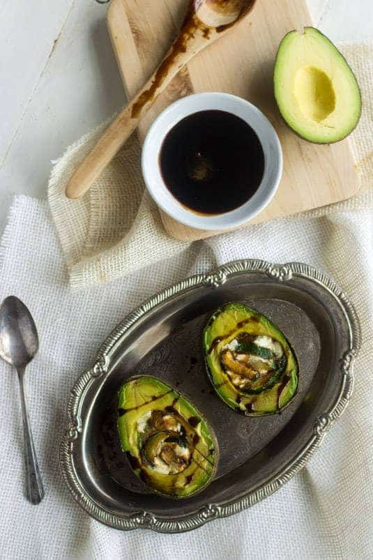 Zucchini and Goat Cheese Stuffed Balsamic Avocados - A quick, easy and healthy snack! - Food Faith Fitness | #healthysnack #avocado #glutenfree