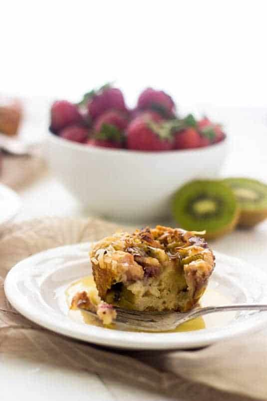 Strawberry Kiwi Bread Puddings with Coconut Rum Sauce - Pretty much your new favorite dessert.   Food Faith Fitness  #breadpudding #dessert #recipe