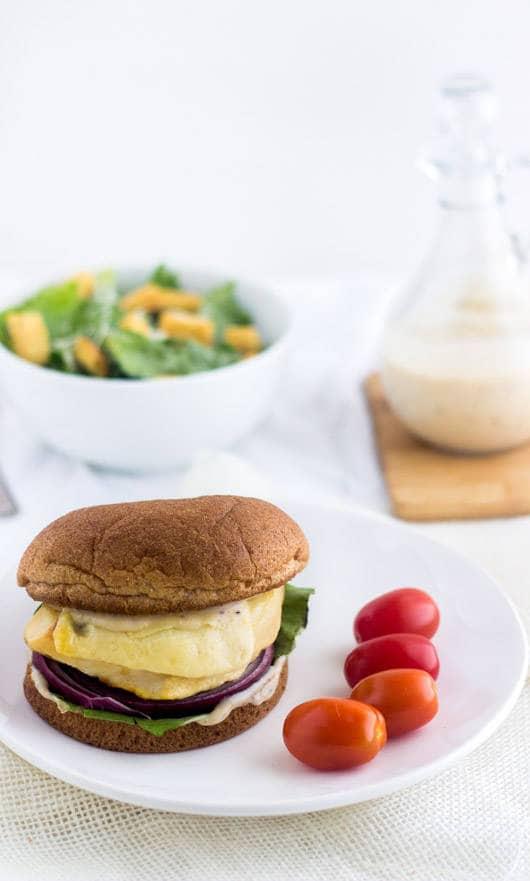 Chicken Caesar Burgers - Like a salad on a bun. Easy, healthy and cheesy! | foodfaithfitness.com | #chicken #burger #recipe