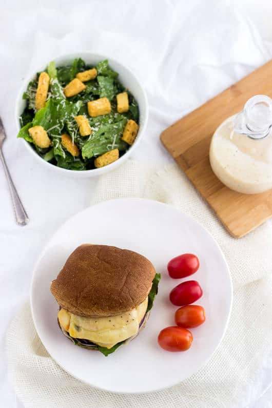 Caesar Grilled Chicken Burger - Ever wondered how to make chicken burgers at home? These taste like a salad on a bun. Easy, healthy, cheesy and only 350 calories and protein packed! | foodfaithfitness.com | @FoodFaithFit