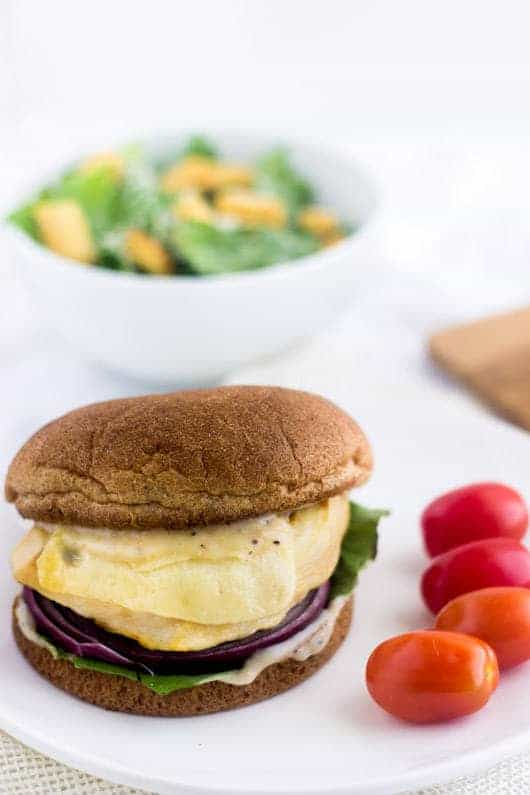 Caesar Grilled Chicken Burger - Like a salad on a bun. Easy, healthy, cheesy and only 350 calories and protein packed! | foodfaithfitness.com | @FoodFaithFit