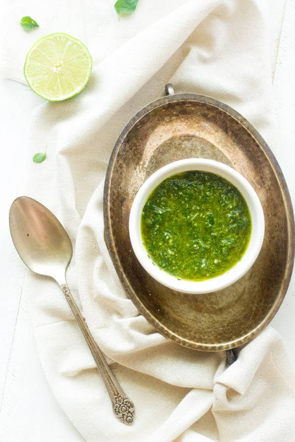 Kale Chimichurri - A quick an easy sauce that is GREAT on meat! |www.foodfaithfitness.com| #glutenfree #recipe #kale