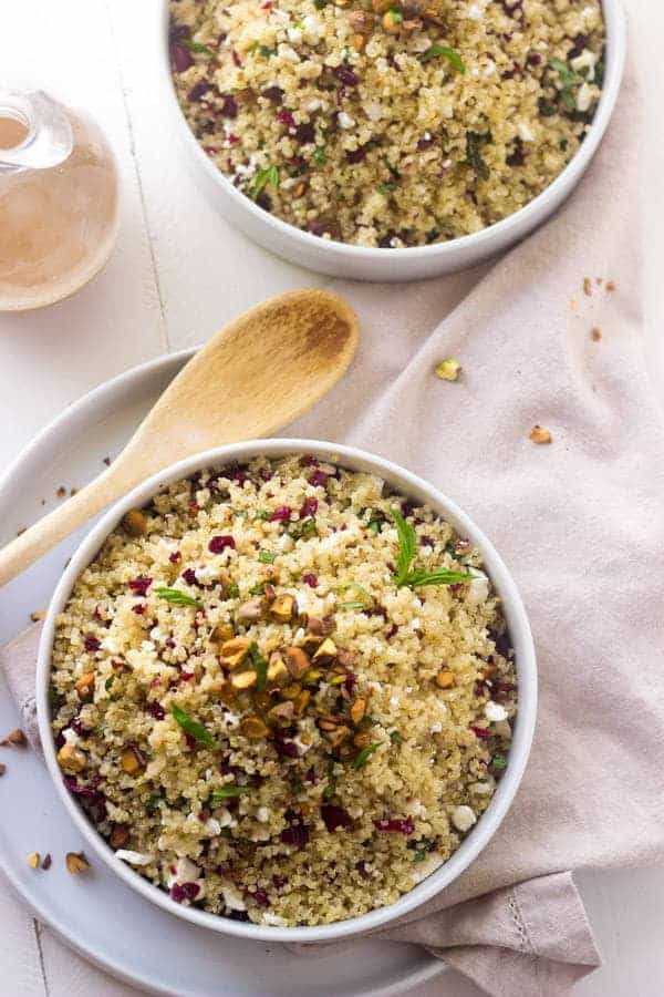 Pistachio Cherry And Feta Quinoa Salad - Crunchy, sweet and tangy this is SO easy and delicious! |www.foodfaithfitness.com| #Recipe #Quinoa #Salad