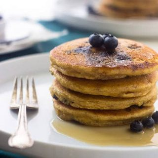 Whole Wheat Ricotta Blueberry Pancakes - The biggest, fluffiest and creamiest pancakes you will EVER eat!   Foodfaithfitness.com   #breakfast #pancake #recipe