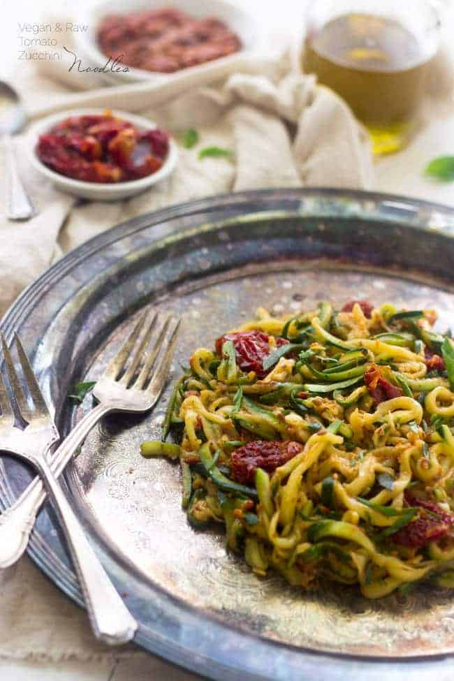 Raw Sundried Tomato Sauce with Zucchini Noodles - An easy meal that is big on flavor, but not on calories! | Foodfaithfitness.com | #raw #vegan #recipe #zucchinoodles