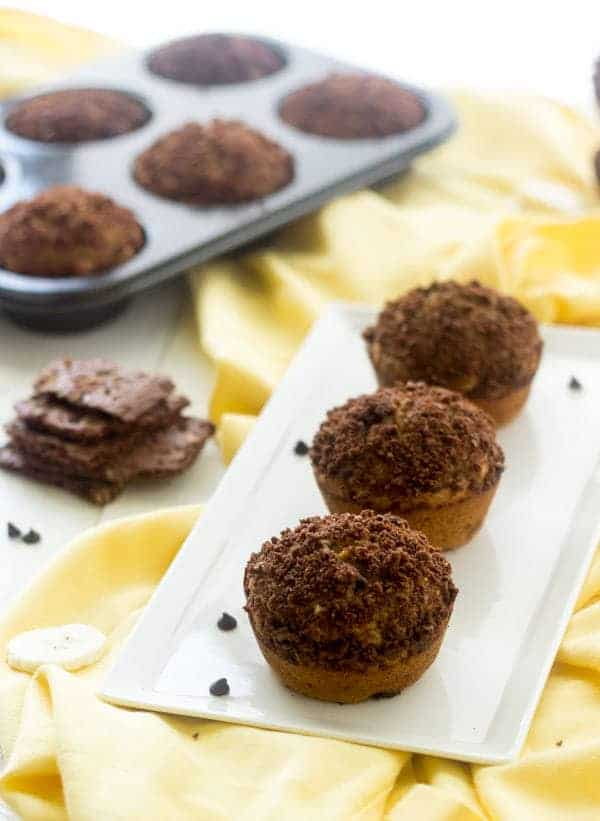 Banana Chocolate Chip Muffins with Brownie Brittle Topping - Whole wheat and oil free, these are great for school lunches!   Foodfaithfitness.com   #muffin #banana #recipe