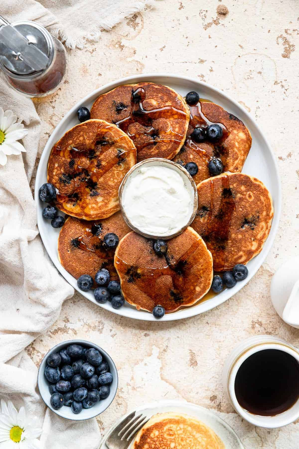 Blueberry pancake recipe on a large plat with sauce