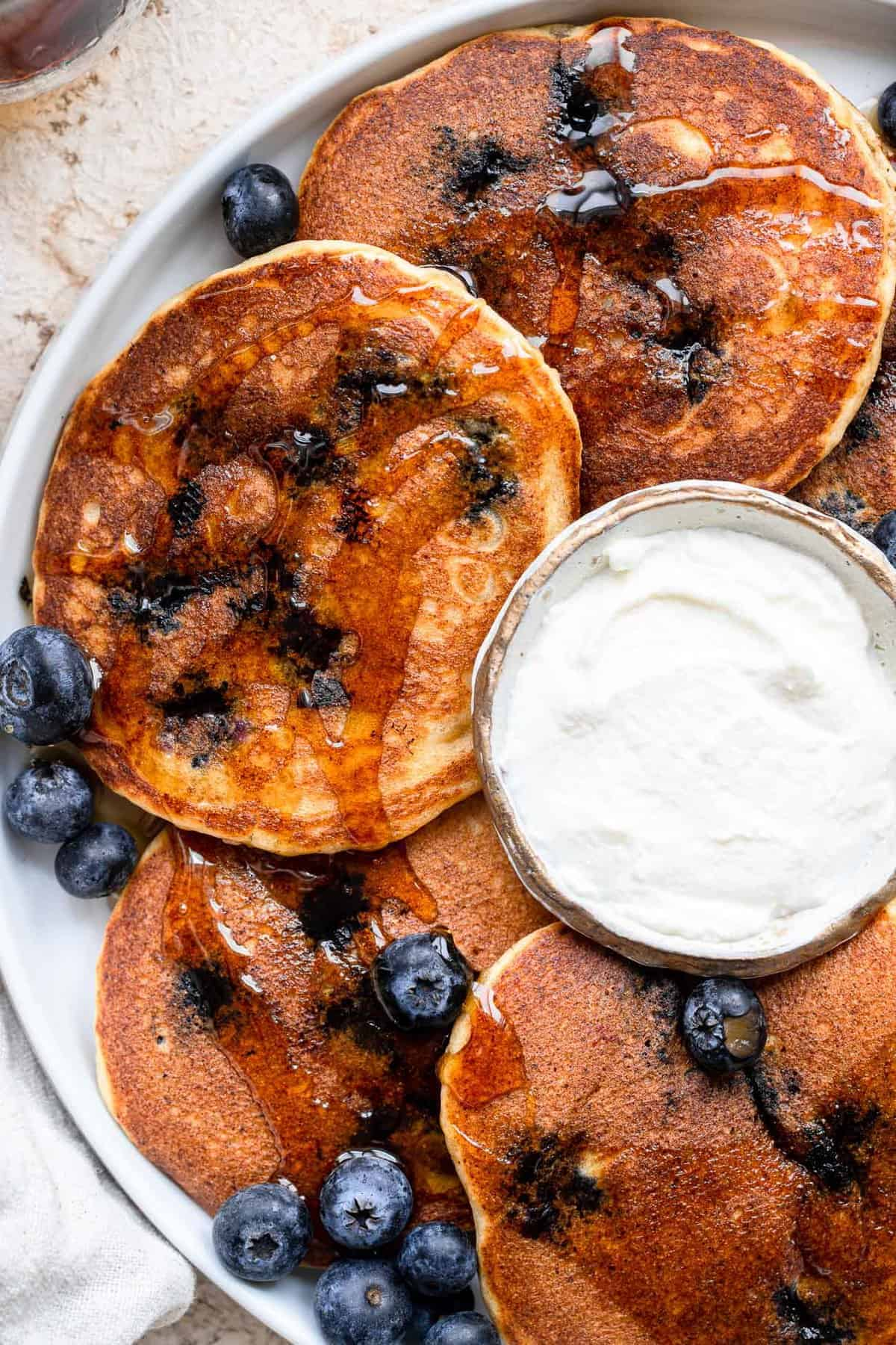 Whole Wheat Blueberry Pancakes with ricotta cheese on plate