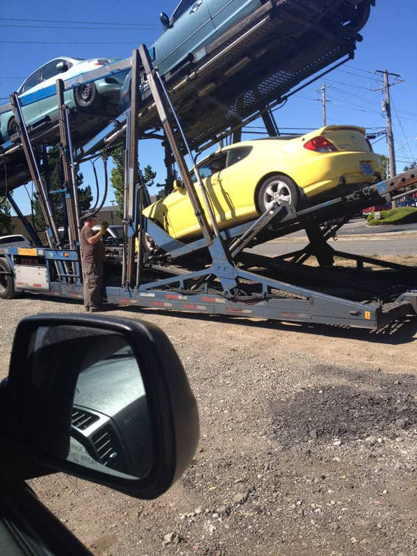 We shipped my car (which I name the 'naner cause its yellow) and watching them take it off the truck was SO SCARY