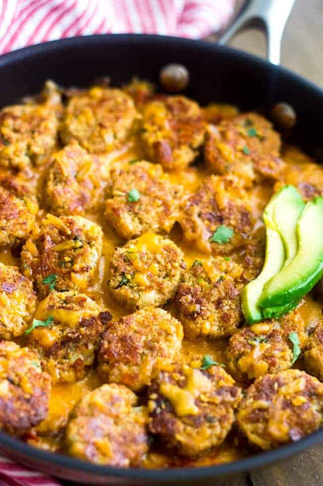 Mexican Cauliflower Tater tot Casserole - So ooey, gooey and cheesy you would never know it's #lowcarb and #healthy! | Foodfaithfitness.com | #recipe #gameday #cauliflower