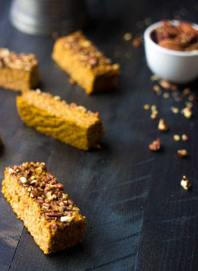 Pumpkin Protein Bars - They taste JUST like pumpkin pie but are easy, #glutenfree and great for on the go breakfasts or snacks! | Foodfaithfitness.com | #pumpkin #proteinbar #recipe