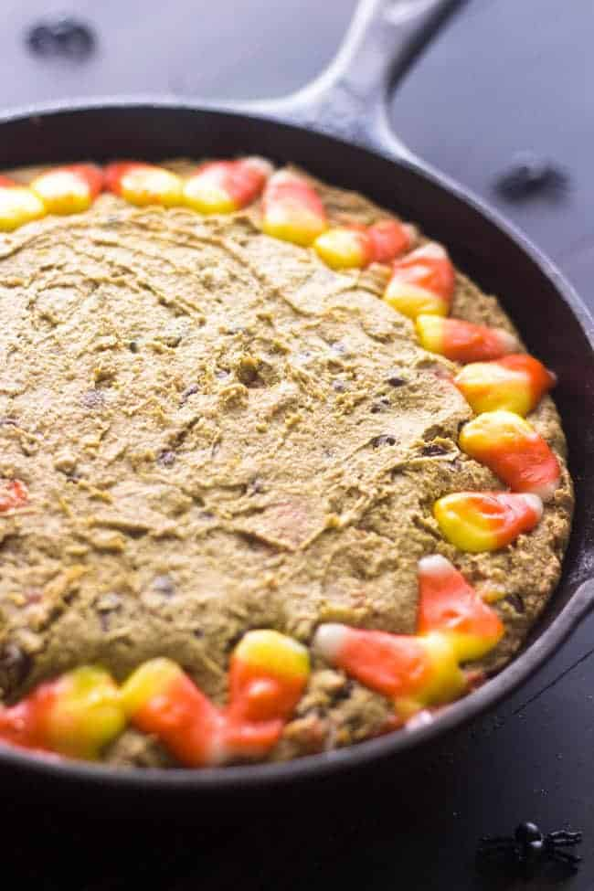 Healthy Halloween Skillet Cookies - 100% Whole Wheat, Butter/oil free and SO thick and chewy. You NEED to try this cookie! | Foodfaithfitness.com | #halloween #skilletcookie #recipe #candycorn