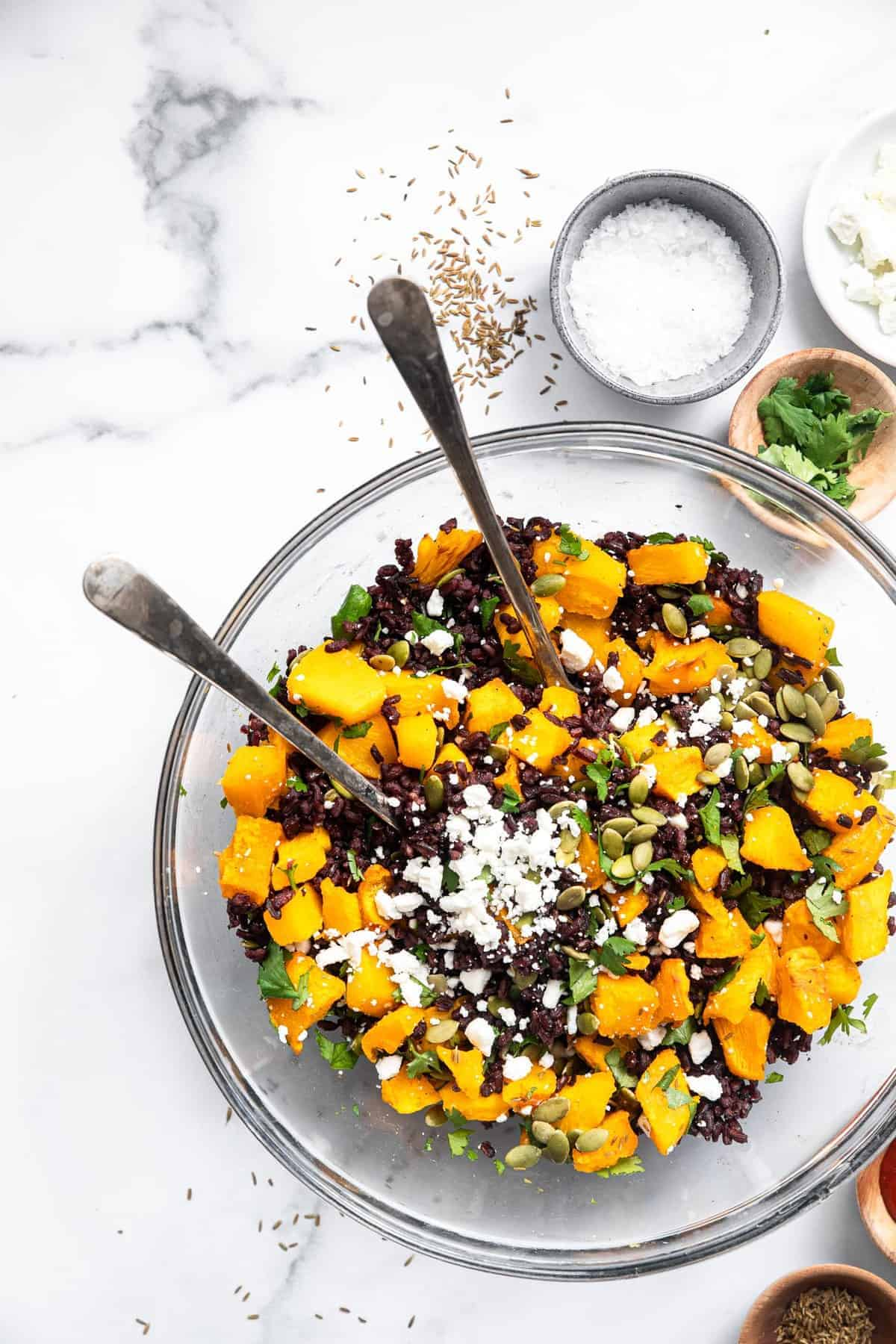 black rice salad with goat cheese in a serving bowl