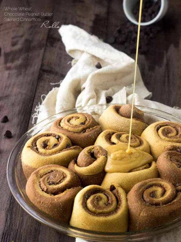 Skinny Chocolate Peanut Butter Swirled Cinnamon Buns - These cinnamon buns are whole wheat and made with Greek yogurt to keep them so light and fluffy! You would never know that they are skinny! You're gonna LOVE them! | Foodfaithfitness.com | #Recipe