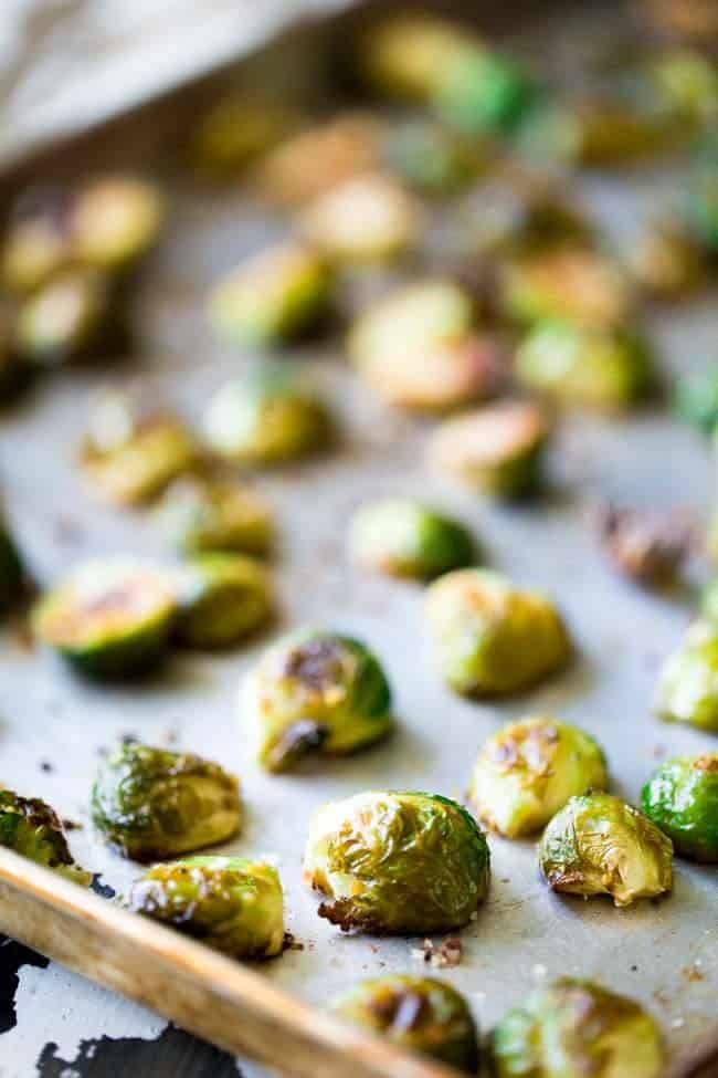 Oven Balsamic Roasted Brussels Sprouts with Goat Cheese - An easy side dish that my HUSBAND called addictive! | Foodfaithfitness.com | #recipe