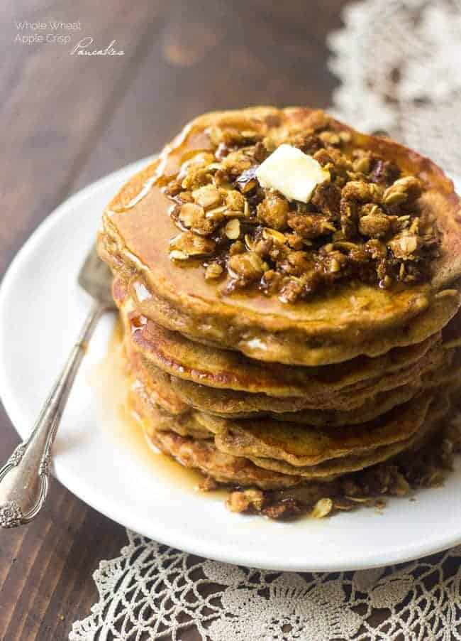 Whole Wheat Apple Crisp Pancakes - These pancakes taste like dessert for breakfast! Using Greek yogurt keeps them light, healthy and SO creamy! | Foodfaithfitness.com | #recipe
