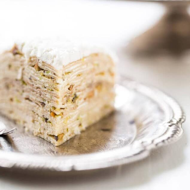Coconut Pistachio Crepe Cake - A showstopping dessert that is surprisingly EASY! Perfect to impress at your Christmas table! | Foodfaithfitness.com | #recipe