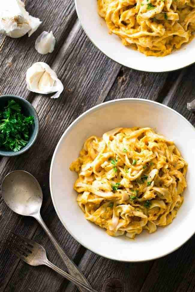 Creamy Pumpkin Pasta - A secret, 10 calorie noodle keeps this pasta healthy! It's quick, easy and perfect for a comforting, weeknight meal! | Foodfaithfitness.com | #recipe