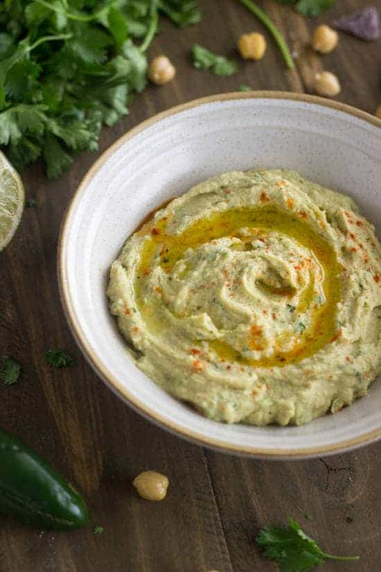 Cilantro Lime Hummus - So quick, easy and healthy! There's no weird ingredients either!   Foodfaithfitness.com   #recipe