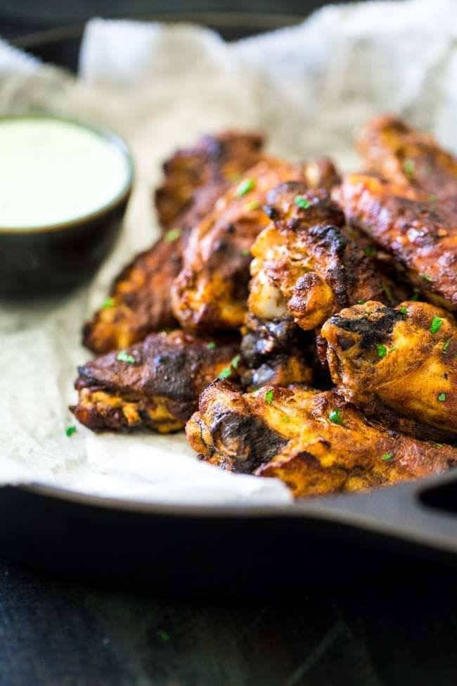 Tandoori Crispy Baked Chicken Wings - Marinated in Greek yogurt and baked, not fried, these super easy chicken wings.with a little Indian spice, are a healthier crowd pleaser! | Foodfaithfitness.com | #recipe