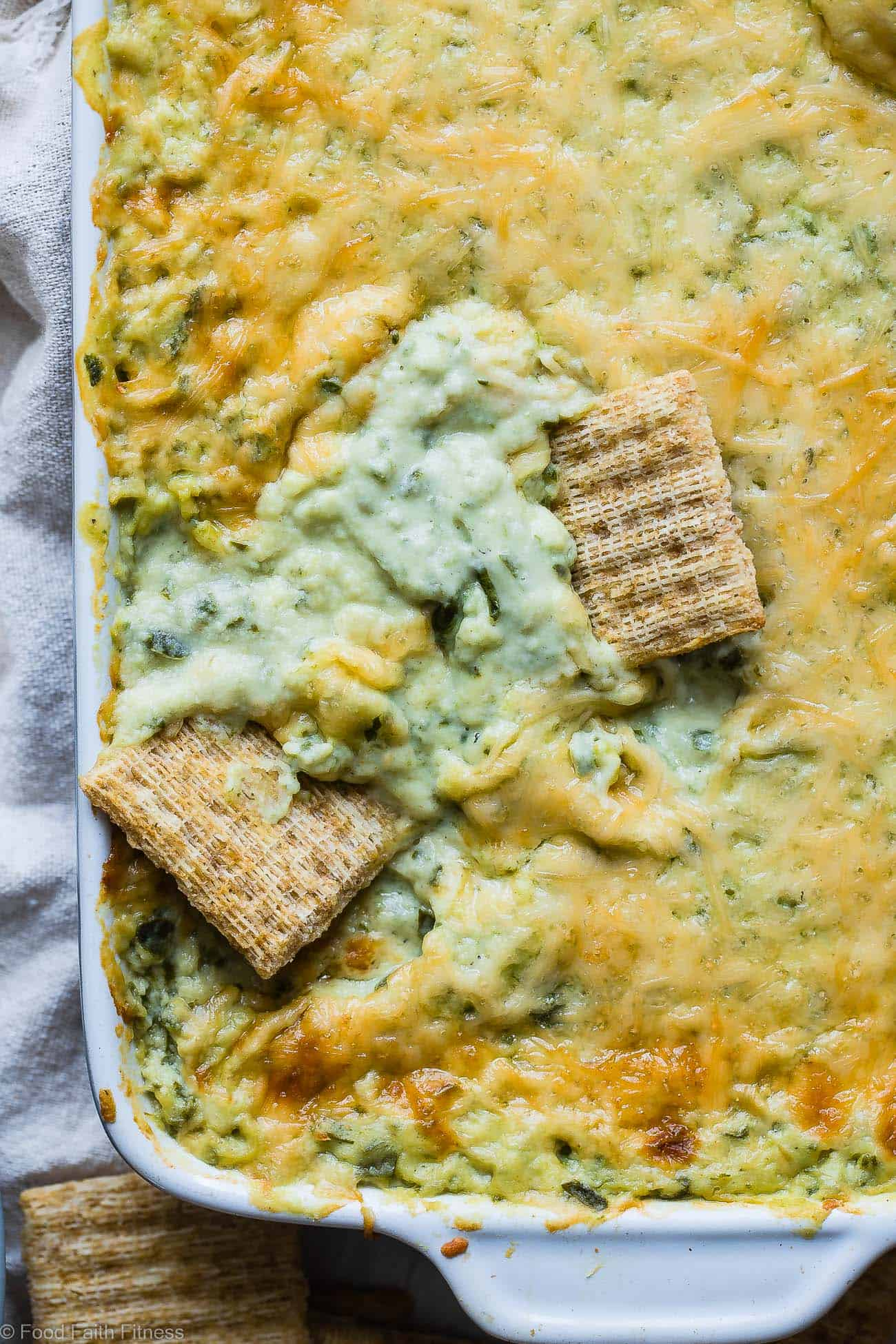 Easy Homemade Greek Yogurt Spinach Dip - This easy, cheesy, baked dip uses Greek yogurt to make it SUPER thick and creamy! It's low carb, protein packed and always a hit at parties! No one believes it's healthy! | Foodfaithfitness.com | @FoodFaithFit