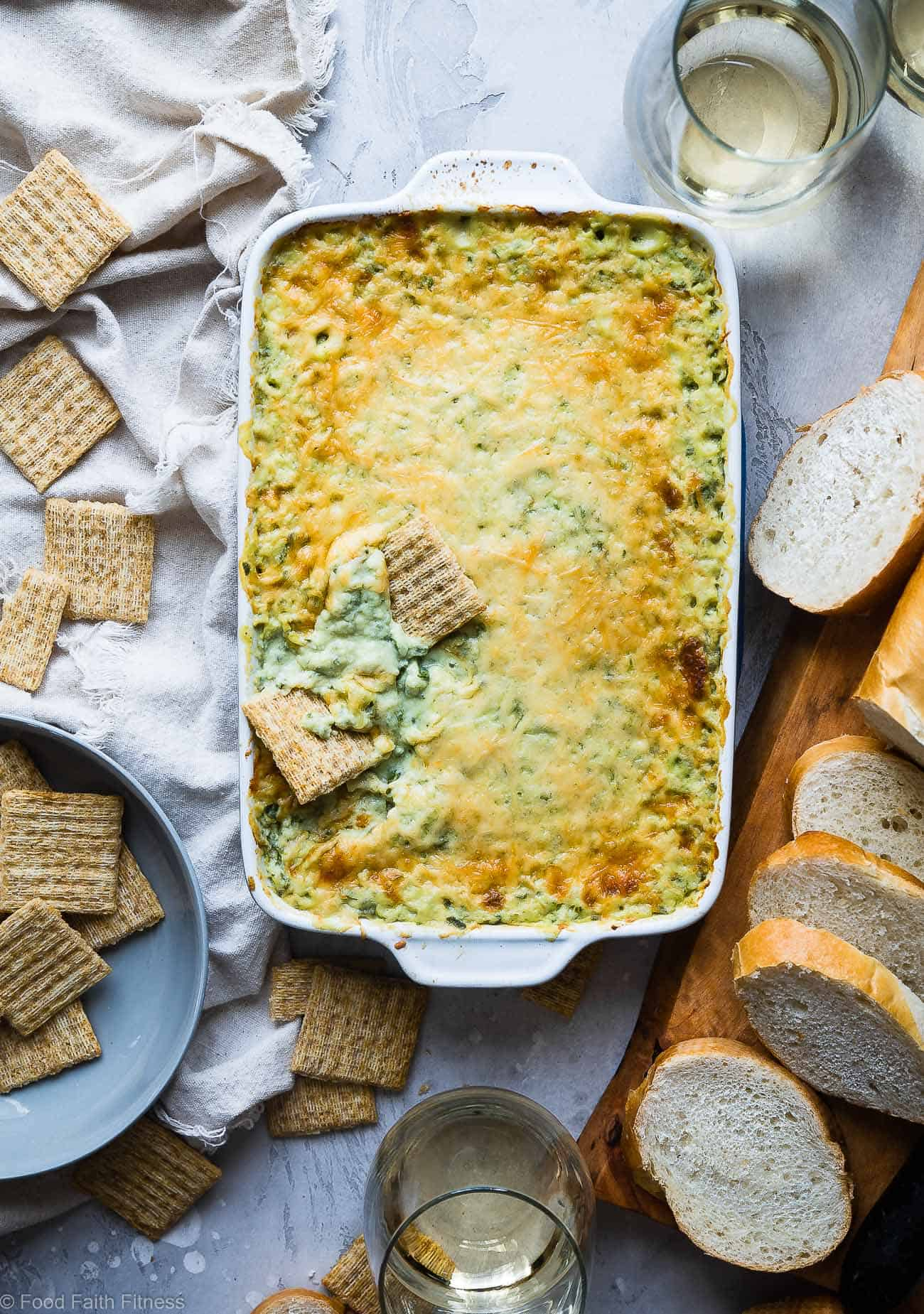 Easy Homemade Spinach Greek Yogurt Dip - This easy, cheesy, baked spinach cheese dip uses Greek yogurt to make it SUPER thick and creamy! It's low carb, protein packed and always a hit at parties! No one believes it's healthy! | Foodfaithfitness.com | @FoodFaithFit