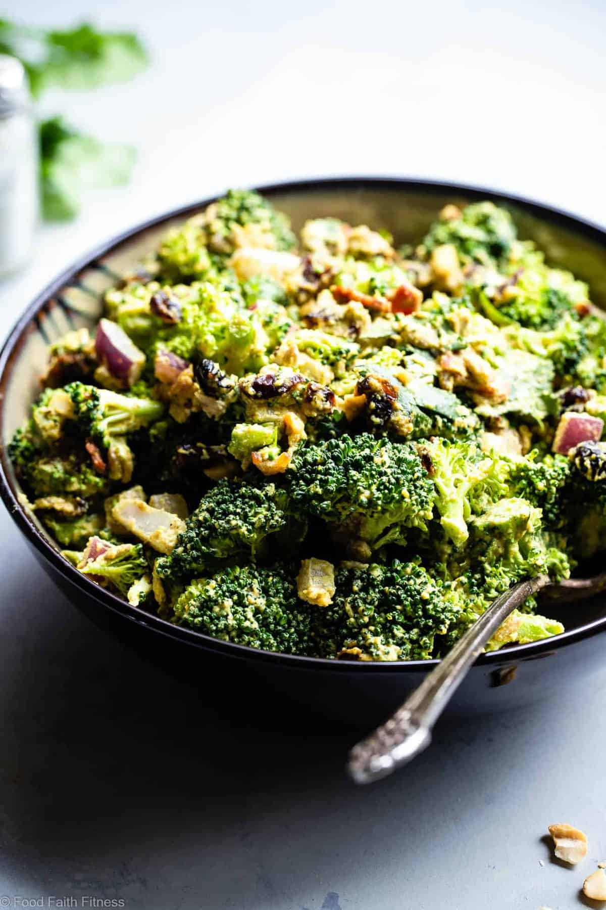 Curried Vegan Paleo Broccoli Cashew Salad -  This easy healthy broccoli salad is jazzed up with a curried cashew cream dressing. It's a quick, easy, gluten and dairy free side that's always a crowd pleaser! | #Foodfaithfitness | #Glutenfree #Paleo #Vegan #Dairyfree #Healthy