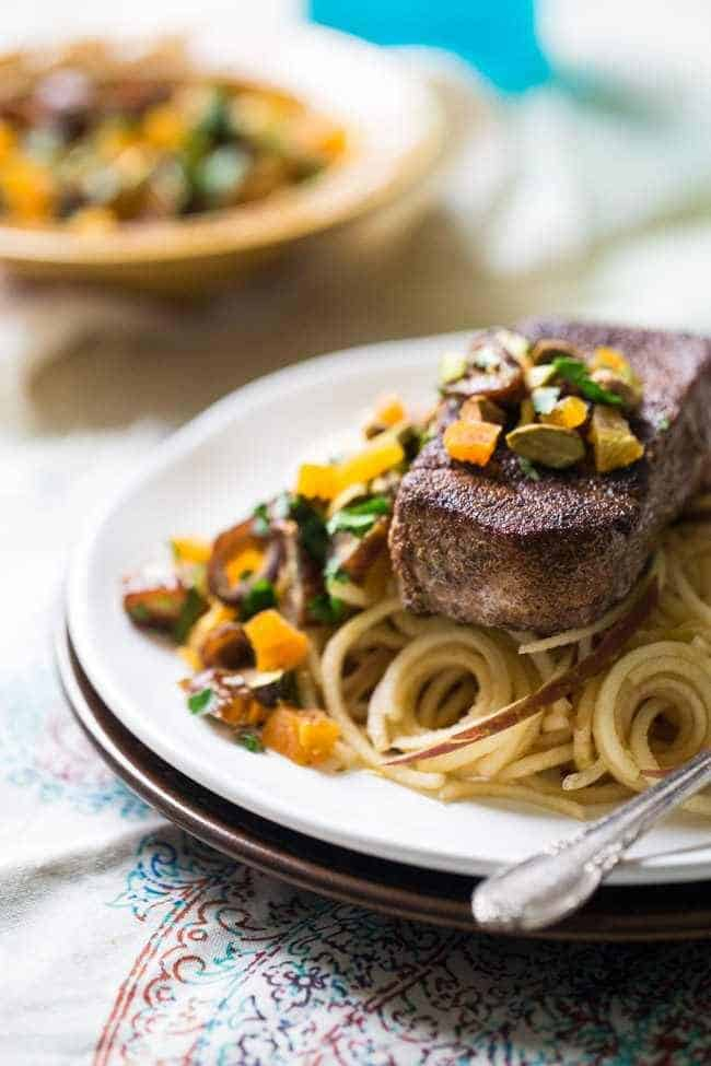 Morrocan Style Paleo Pork Chops with Spiralized Apples Noodles - So JAM packed with flavor, this meal is ready in under 30 minutes and is healthy, grain, dairy and gluten free!   Foodfaithfitness.com   @FoodFaithFit