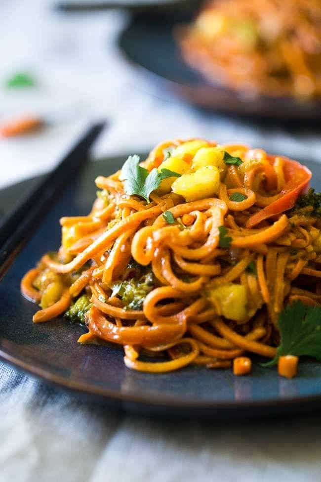 Vegan Coconut Sweet Potato Curry with Sweet Potato Noodles – This curry is ULTRA creamy and loaded with veggies, for a quick and SO easy, healthy dinner that is gluten free, vegan and paleo friendly! This has RAVE reader reviews! | #FoodFaithFitness | #Glutenfree #Vegan #Paleo #Dairyfree #Healthy