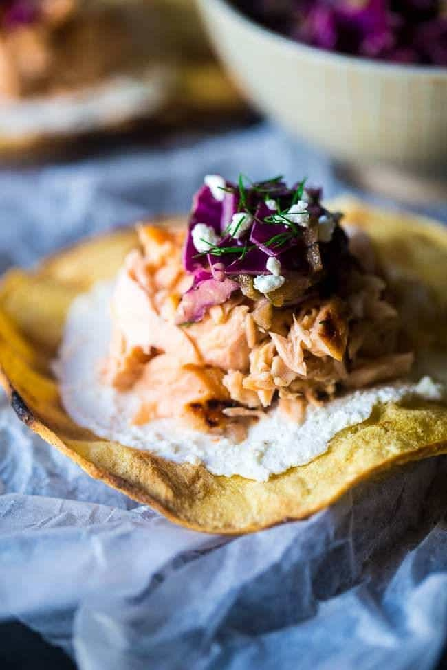 Grilled Maple Salmon Tostadas – Crunchy grilled tortillas are topped with Dijon mustard slaw and creamy goat cheese for a gluten free, healthy meal or appetizer, that's so easy to make! | Foodfaithfitness.com | @FoodFaithFit