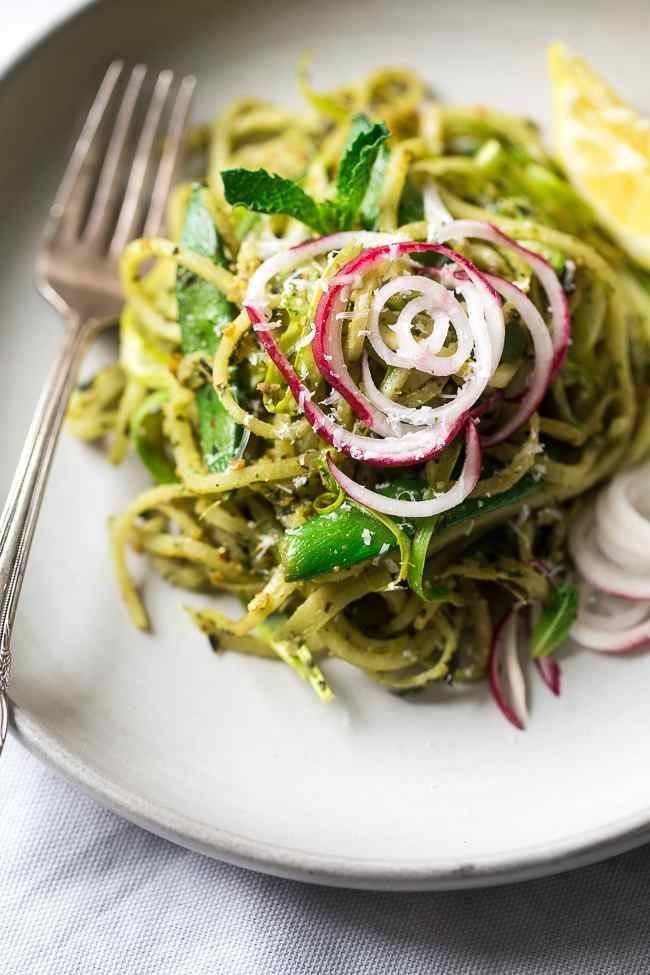 Turnip Noodle Pesto Pasta Salad with Peas and Asparagus – Spiralized turnips, asparagus and peas are tossed with pesto for a light, healthy and easy Spring meal! Low carb, gluten free and Vegetarian! | Foodfaithfitness.com | @FoodFaithFit