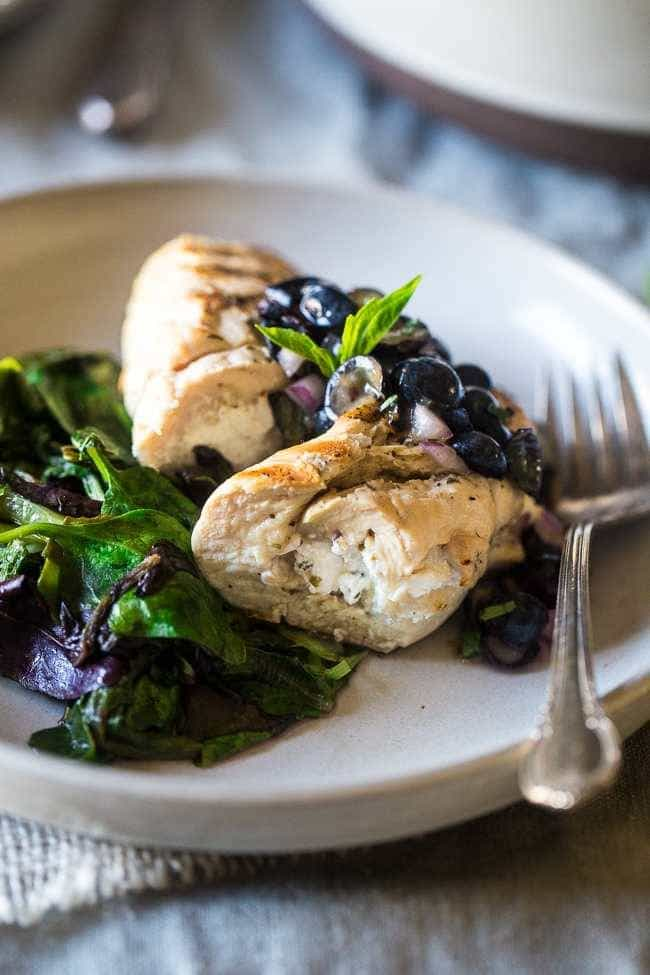 Grilled Goat Cheese Stuffed Chicken Breasts with Balsamic Blueberry Salsa – A 30 minute, easy, healthy dinner that feels fancy! Perfect for summer entertaining! | Foodfaithfitness.com | @FoodFaithFit