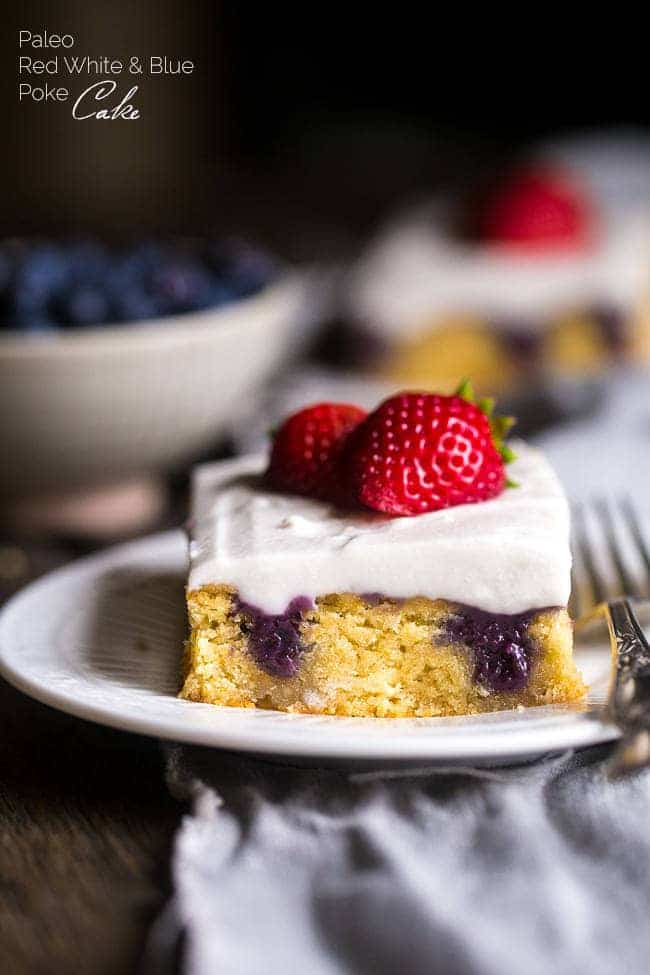 Paleo Poke Cake with Blueberries, Strawberries and Coconut Cream - The sweet pockets of homemade blueberry filling make this cake SO moist! It's topped with whipped coconut cream and strawberries for an easy, healthier dessert that is perfect for July 4th! | Foodfaithfitness.com | @FoodFaithFit