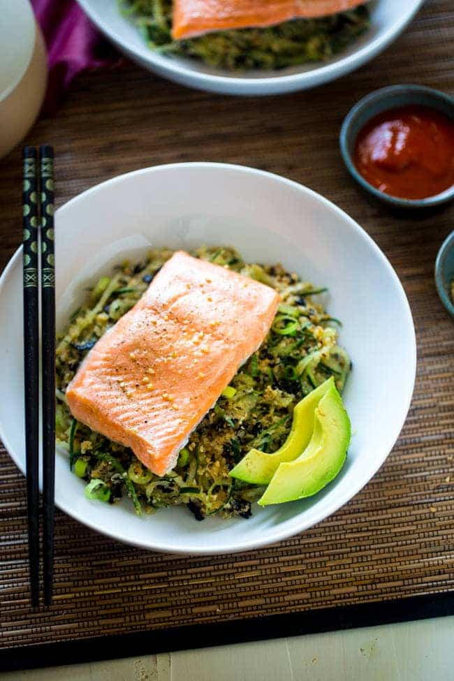 Paleo Spicy Salmon Cauliflower Rice and Cucumber Noodle Sushi Bowl - Cauliflower rice and cucumber noodles are tossed with a spicy, Asian dressing, nori and salmon for a healthy, paleo-friendly meal that tastes like a spicy salmon roll! | Foodfaithfitness.com | @FoodFaithFit
