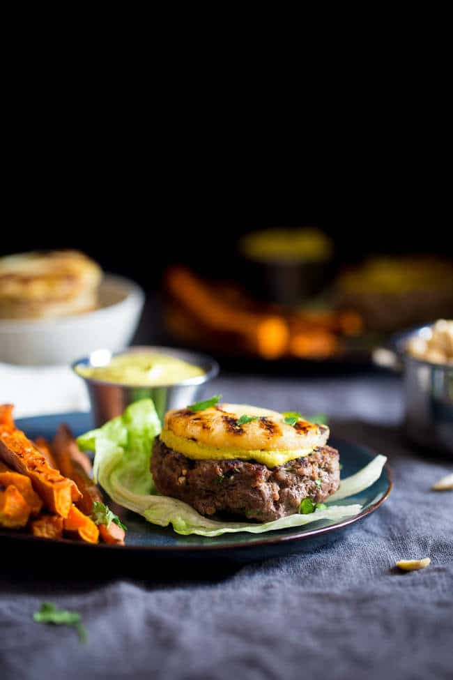 Paleo Burgers with Grilled Pineapple and Curry Cashew Cream - Topped with smooth and spicy curry cashew cream, grilled pineapple and wrapped with lettuce, this burger is a low carb, healthy meal for under 250 calories! | Foodfaithfitness.com | @FoodFaithFit