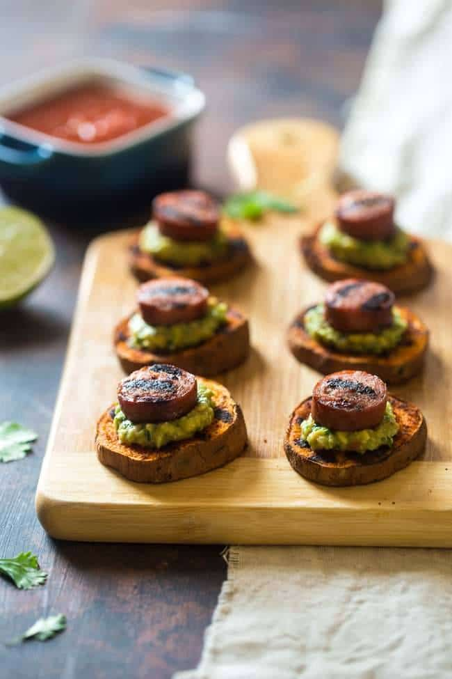 Spicy Grilled Sweet Potatoes with Avocado Salsa and Turkey Sausage - Grilled Sweet Potatoes are covered with creamy, smooth avocado salsa and turkey sausage for a quick, easy and healthy appetizer! Perfect for summer entertaining! | Foodfaithfitness.com | @FoodFaithFit