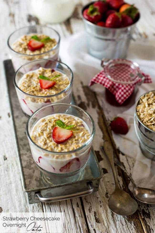Strawberry Cheesecake Overnight Oats - These overnight oats are layered with a mixture of strawberry jam, cream cheese and Greek yogurt for a quick and easy, high-protein breakfast that feels like dessert! | Foodfaithfitness.com | @FoodFaithFit