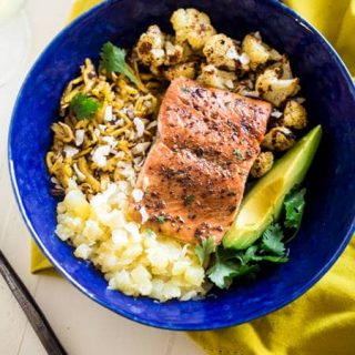Caribbean Salmon Plantain Noodle Bowls - Plantain noodles are mixed with pineapple, spicy roasted cauliflower, sweet baked salmon and topped with coconut avocado sauce for a tropical, paleo meal! | Foodfaithfitness.com | @FoodFaithFit