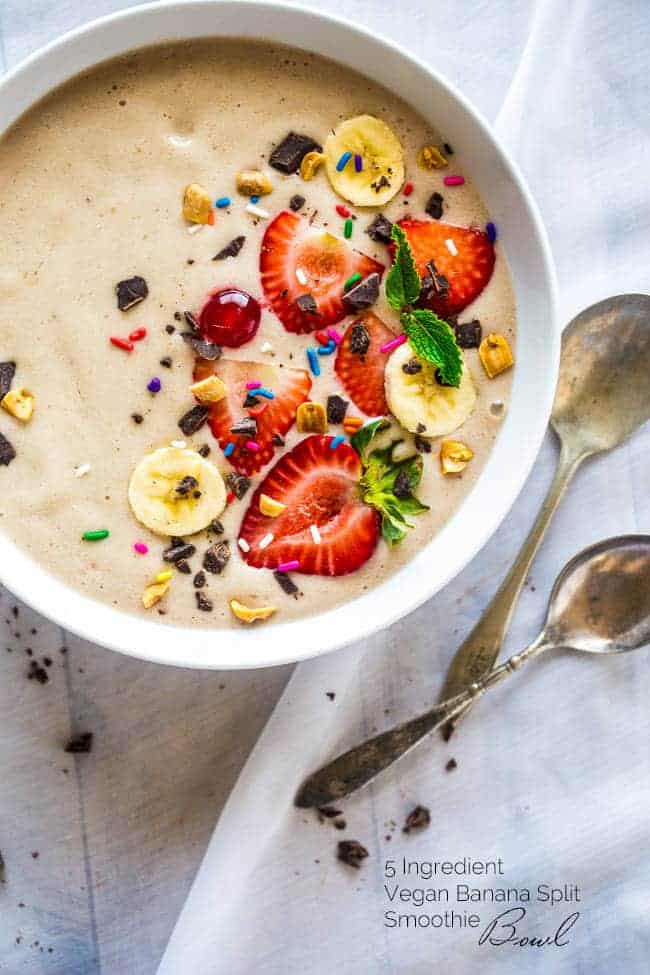Banana Split Vegan Smoothie Bowl - Made with only 5 ingredients, ready in 5 minutes, tastes like a banana split, and is secretly healthy enough for breakfast! Paleo friendly and gluten free too! | Foodfaithfitness.com | @FoodFaithFit