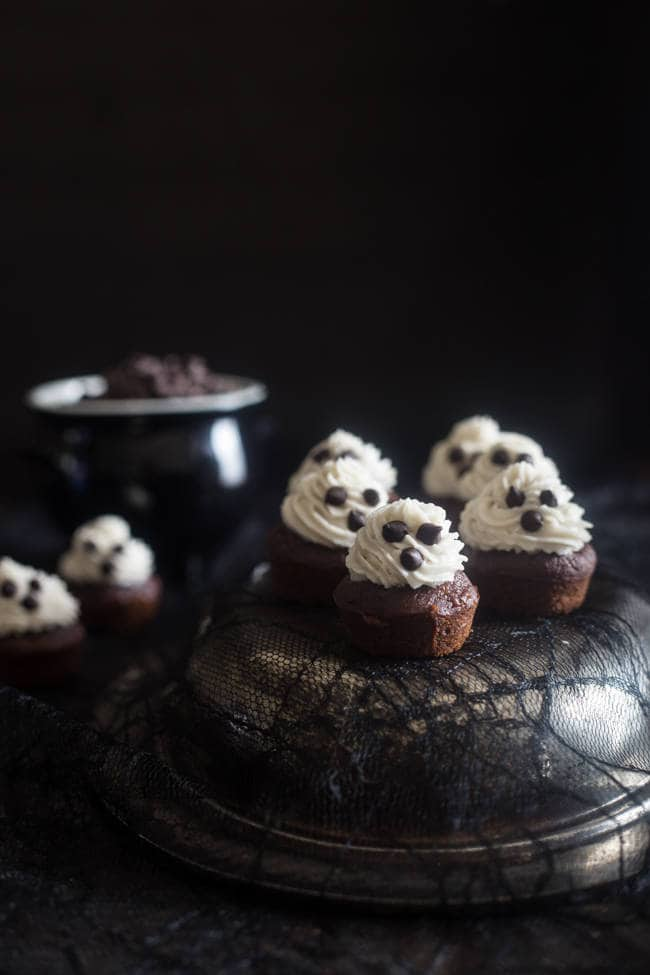 Paleo + Vegan Spooky Mini Chocolate Banana Cupcakes with Coconut Cream - These mini cupcakes are naturally sweetened, paleo and vegan friendly and are only 100 calories! They're always a hit at Halloween parties! | Foodfaithfitness.com | @FoodFaithFit