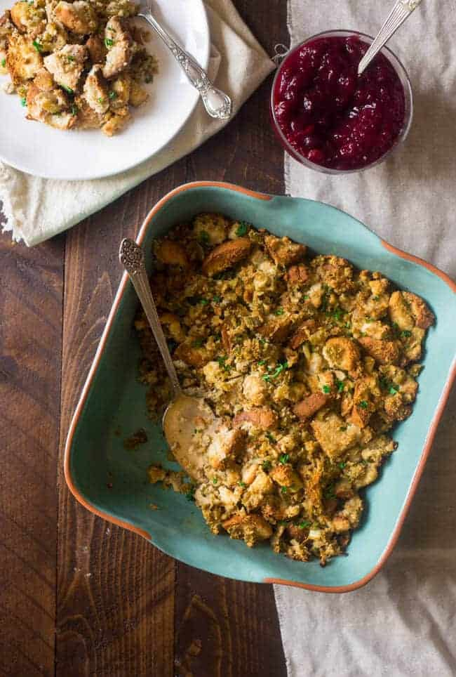 Easy Gluten Free Stuffing - This stuffing is moist and so packed with flavor, you would never know how easy it is to make! Perfect for Thanksgiving or any holiday meal! | Foodfaithfitness.com | @FoodFaithFit