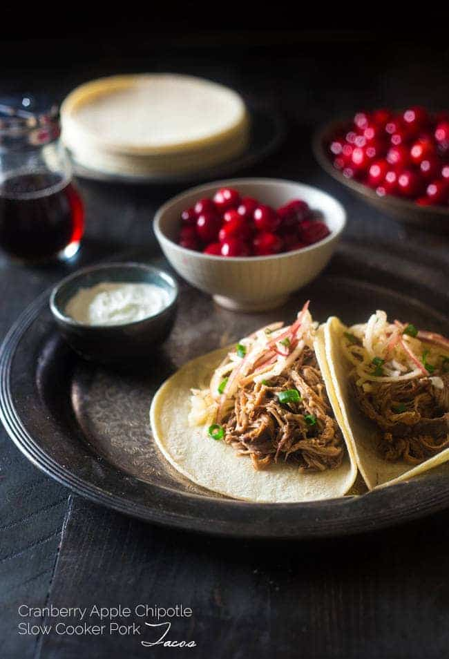 Gluten Free Cranberry, Apple Chipotle Slow Cooker Pork Tenderloin Tacos - These healthy tacos are packed with spicy-sweet, fall flavor and are an easy, weeknight meal that the whole family will love! | Foodfaithfitness.com | @FoodFaithFit
